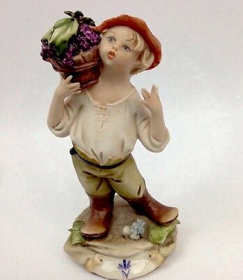Capodimonte Signed Porcelain figurine boy carrying a bucket of grapes