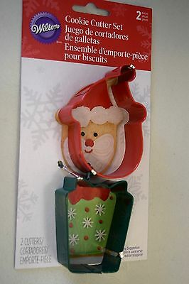 NEW LOT OF 2 METAL COOKIE CUTTERS WILTON SANTA FACE AND GIFT SHAPE