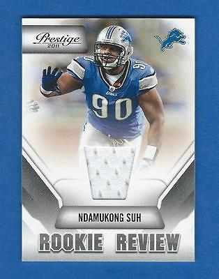2011 PRESTIGE ROOKIE REVIEW MATERIAL #31 NDAMUKONG SUH JERSEY FOOTBALL CARD