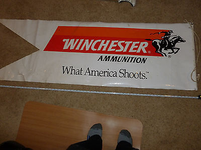 "Winchester Ammunition What America Shoots Flag style Banner , 22"" x 68 "" ."