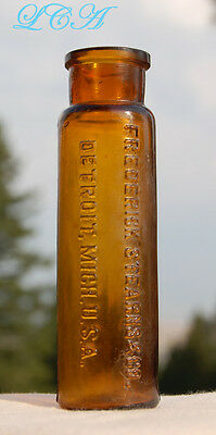 Small brown antique STEARNS GONORRHEA CURE embossed vial - AMBER glass