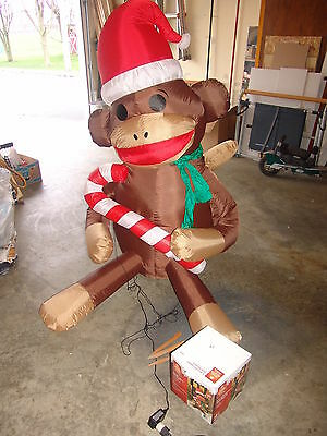 """5' 4"""" Inflatable Lighted HOLIDAY SOCK MONKEY with Santa Hat and Candy Cane Decor"""