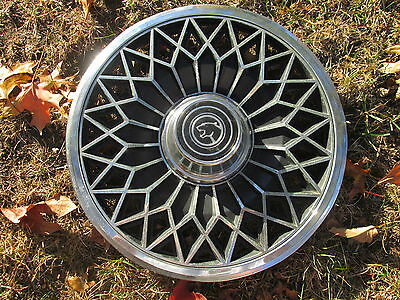one 1980 Mercury Cougar hubcap wheelcover
