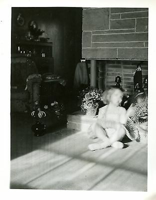 Old B/W Photo young girl sitting by fireplace in sun