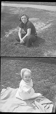 Old B/W Photo negative 1930's young girl stick tongue out and baby
