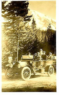 Old 10x6 b/w photo group of people in early automobile mountain backdrop