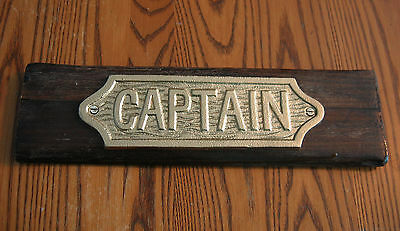 Cast Iron Brass Finished CAPTAIN Sign on Super Storm Sandy Salvaged Boat Trim