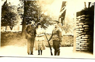 Old b/w photo young couple 1920's soldier rifle sandbags