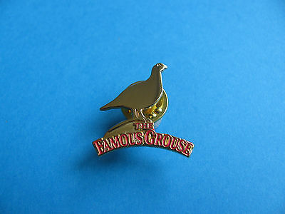 The Famous Grouse Scotch Whisky Pin Badge. Metal Gold Coloured. VGC. Unused.