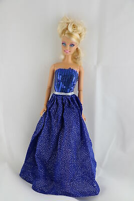 A Brilliant Blue Gown in Blue Sparkles and Sequined Bodice