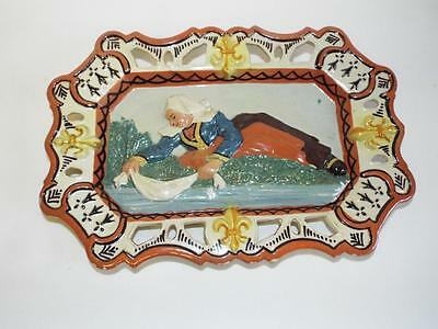 Antique French Porquier Beau bas relief plaque of a washer woman.