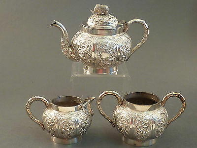 INDIAN SILVER FINELY CHASED BACHELOR 3pc TEA SET, ELEPHANT FINIALS