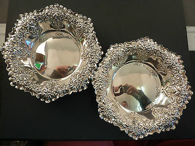 Large Pair Of Ornate Silver Dishes
