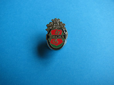 Small Becks Beer pin badge. VGC. Unused. Hard Enamel. Beck's