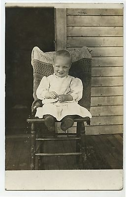 Old RPPC Real Photo Postcard Baby Sitting in Chair on Front Porch
