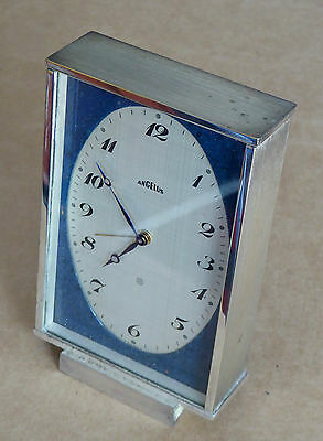 Angelus Watch Co. 8 day clock, calibre Arogno 7321, chrome front, for repair.
