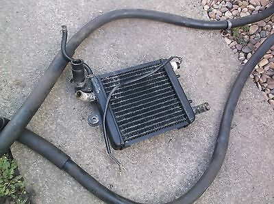Suzuki AY50 WV radiator with two long hoses