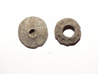 A set of  Perfect Roman Lead spindle whorls 1 BC - 1 AD