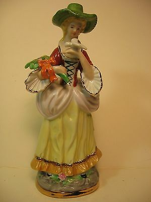 """Vintage 9 1/2"""" Ceramic Figurine Of A Woman With Flowers And A Bird"""