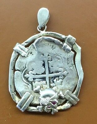 Authentic 8 reale in a silver bezel. Pirate money