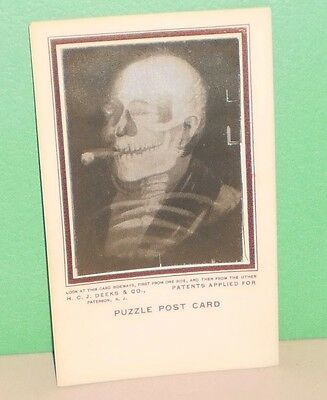 FAB! Vintage  1900's  HCJ Deeks Co. Hologram Puzzle  Post Card  Skeleton/Old Man