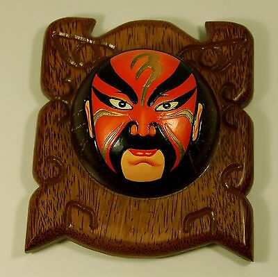 "LINGGUAN (RED FACE GOD) CARVED COCONUT MASK ON WOOD BOARD ,7"" Wide & 8"" Long"
