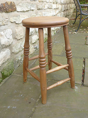 Vintage round topped stool on turned legs Original.