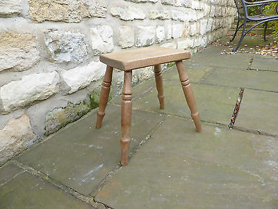 Vintage oblong topped beech stool on turned legs Original.