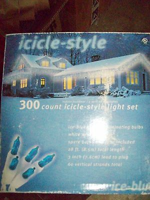 "300 Icicle Lights Ice Blue 28 Ft Total Length 3"" Lead To Plug 60 Vertical Strand"
