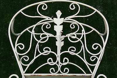 antique or vintage magazine stand rack lots of metal swirls shabby metal swirls