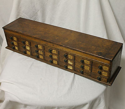 Country Store Watchmaker's Oak file cabinet with 21 drawers, lift-top