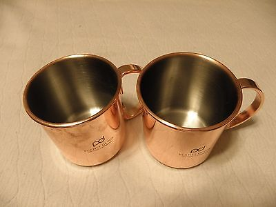 Pair of copper mugs