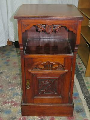 Vintage Dark Wood Cabinet with Intricate Carved Pattern