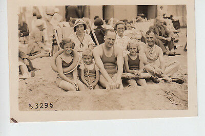 Portrait postcard showing Family on beach at Margate, Kent