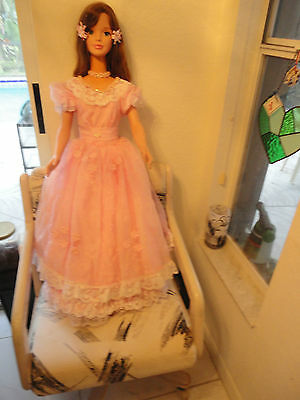 My size Angel Barbie w/ re rooted brown hair & a beautiful pink gown & hat.