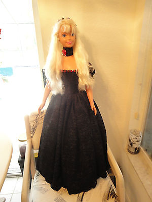 My size Barbie 36 inches tall wearing a black chiffon gown trimed in red
