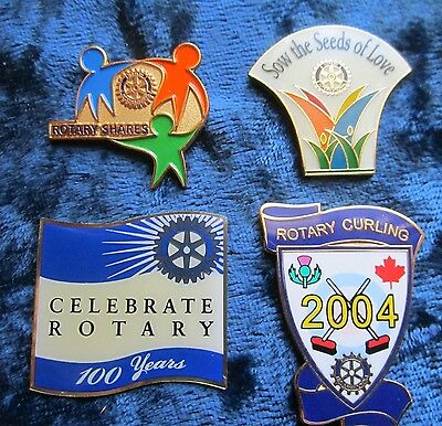 Collection of 4 Mint Rotary Club Pins