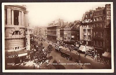 REAL PHOTO POSTCARD SOMERSET HOUSE STRAND SHOP FRONT WESTMINSTER LONDON c1920