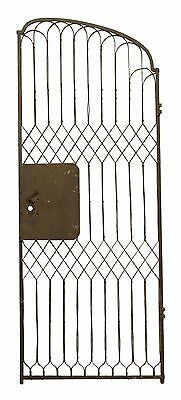 Tall Slanted Curved Iron Gate