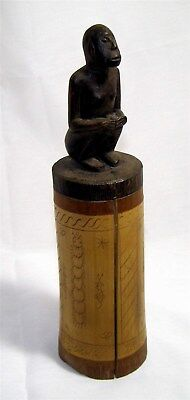 Vintage rare African wood slit drum with figural handle and incised decoration