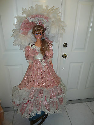 my size barbie 36 inches with light brown hair wearing a Rustie gown & hat