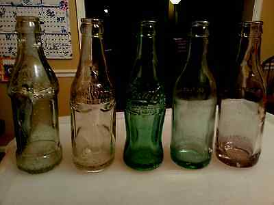 Five Coca Cola Bottles 3 Antique Straight Sided 1 Paneled sides  1 Hobble Skirt