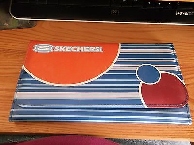 A Card Holder By Skechers Usa. Brand New