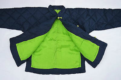 Navy blue quilted Chinese style jacket with green silk trim - age approx 4 years