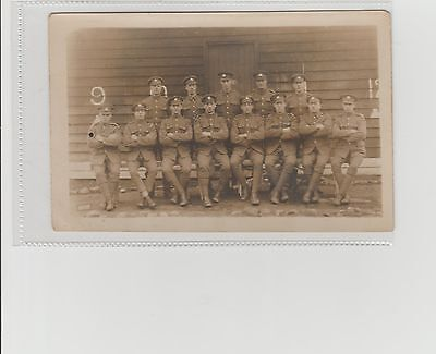 WW1 Soldiers Grouping Outside Barracks Cap Badges Visible RPPC Unposted c1910s