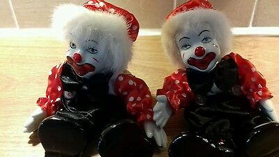 Two pottery bendable clowns