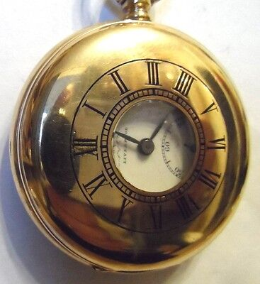A very nice antique Gold Plated Half Hunter Pocket watch by Russell Circa 1920