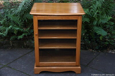 An Ercol Light Elm Tv Hi Fi Dvd Cd Stand Media Cabinet Hall Lamp Table Bookcase