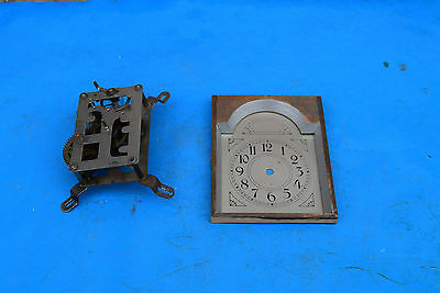 antique clock movement and dial