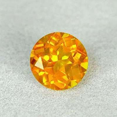 0.96 Ct Orange Brazil Topas Round Facet